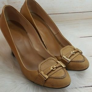 Tod's penny loafer style slip on closed toe heels